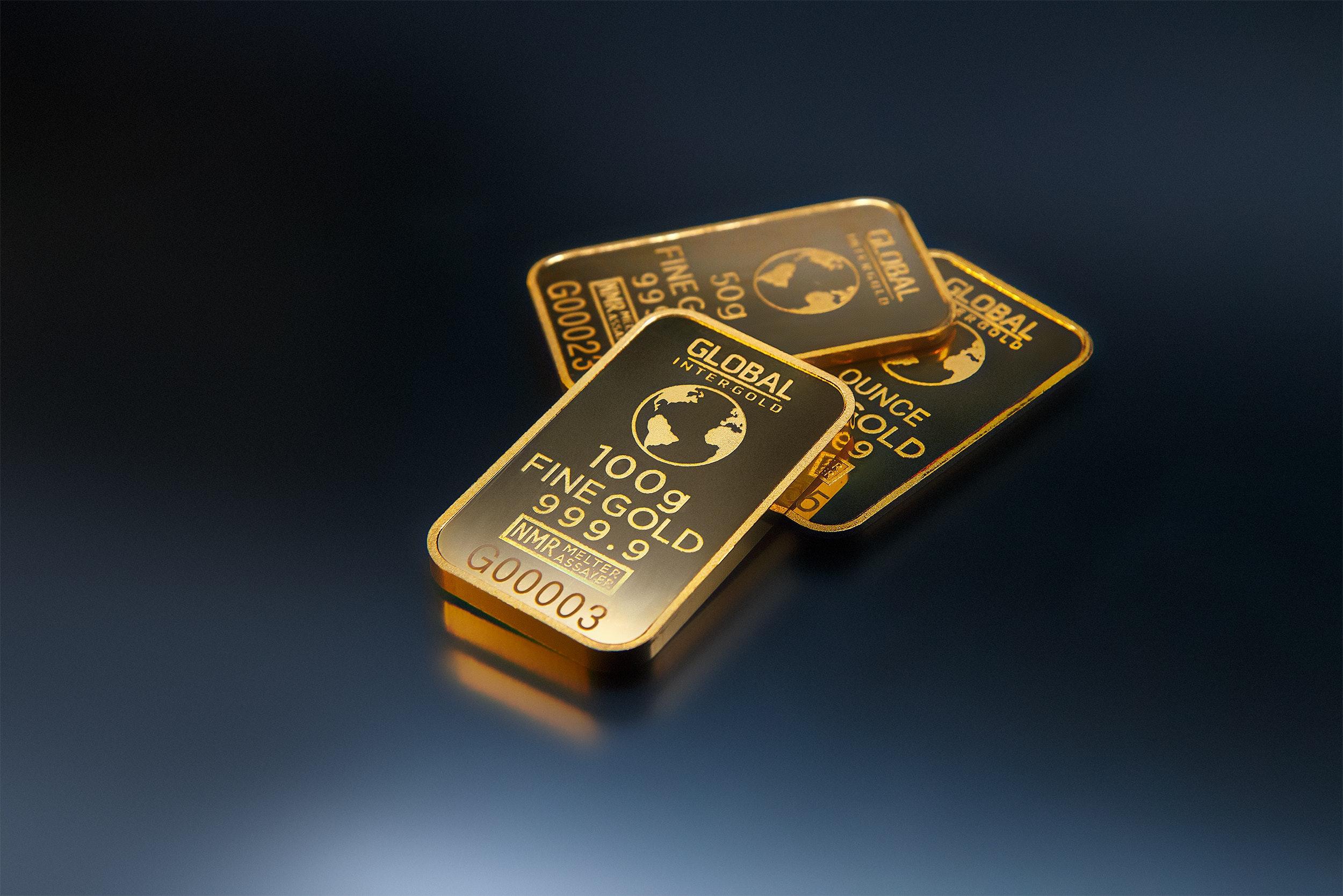 three-gold-bars-against-dark-background-321452.jpg